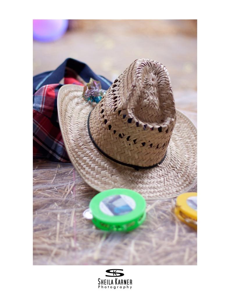 Cowboy hat on a hay bail at a wedding.